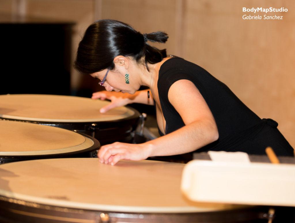 Gabriela playing timpani.