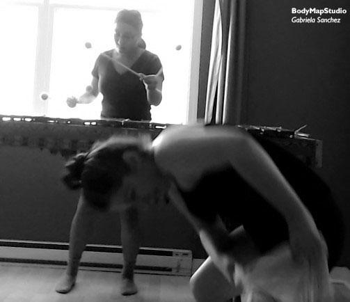Gabriela Sanchez playing marimba and Corie Harnett dancing.