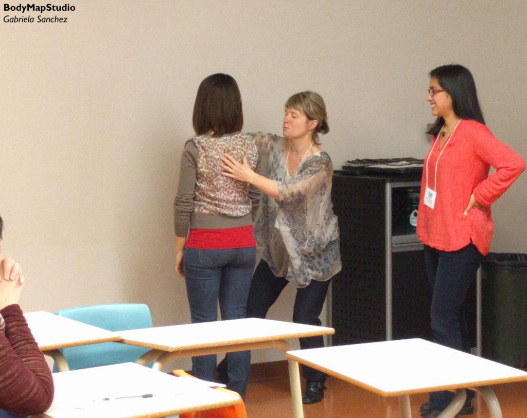 Jennifer Johnson and Gabriela Sanchez help a student to find balance whie standing.