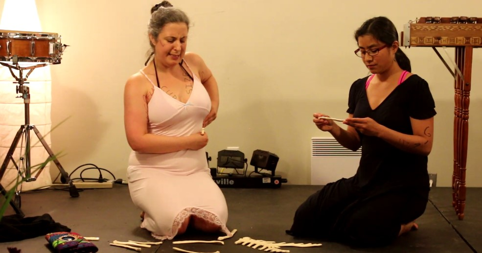 Gabriela Sanchez and Corie Harnett in a performance doing some Body Mapping.